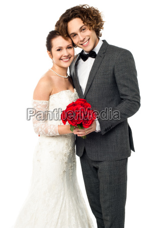 beautiful new bridegroom smiles for the