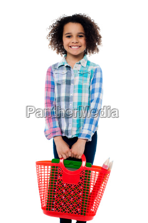 happy school girl carrying stationery in