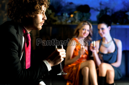 flirtatious young girls staring at handsome