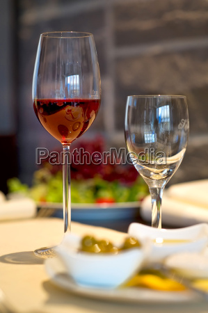 covered dining table with wine glasses