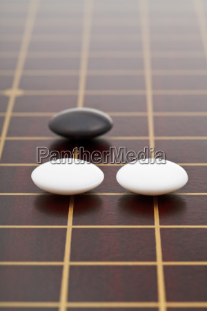 three stones during go game playing