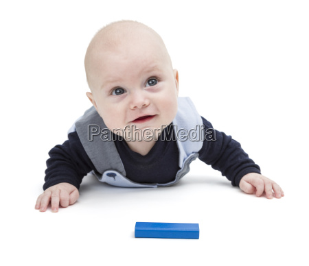 interested baby with toy block