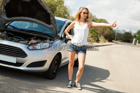 attractive blonde woman on a road
