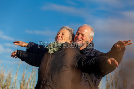 older senior couple laughing happily in