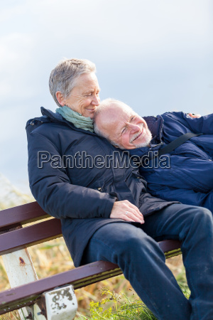 happy relaxed older couple outdoors in