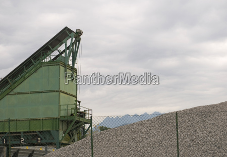 gravel works machinery and gravel pile