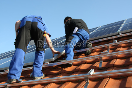 workmen are mounting solar panel