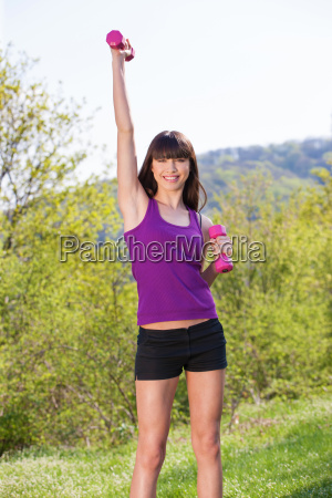 woman doing fitness exercises outdoors