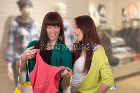 young women shopping for clothes in