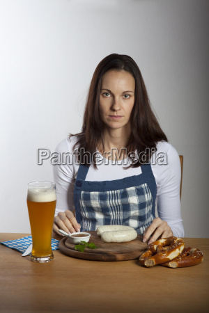 woman with bavarian white sausages