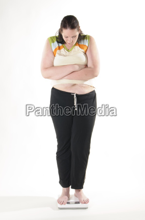 obese adult woman on scales