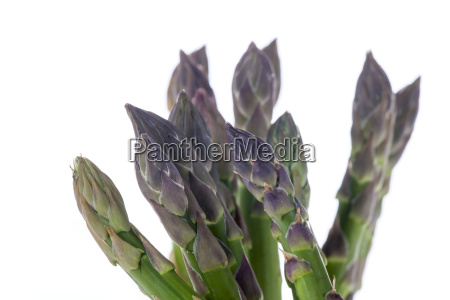 raw green asparagus on white