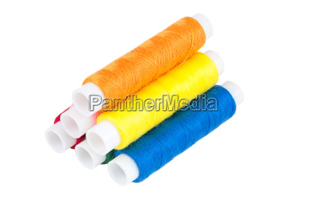 colored spools of threads on a