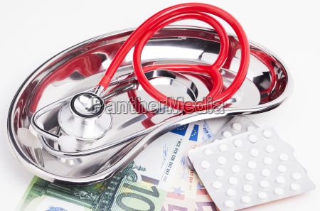 stethoscope money kidney bowl and tablets