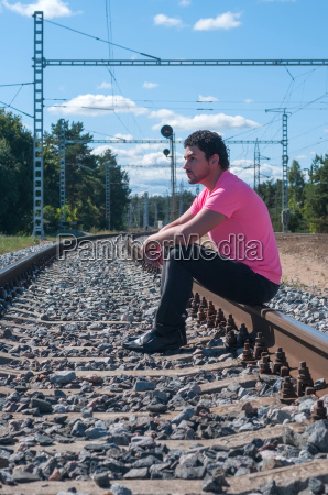 one man in pink t shirt