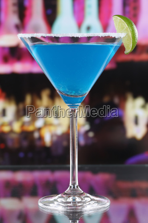 blue curacao cocktail in martini glass