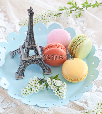 colorful macaraons on blue plate