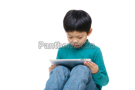 asian little boy using tablet isolated