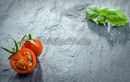 fresh halved tomato and fresh basil