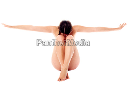naked woman with her arms outstretched