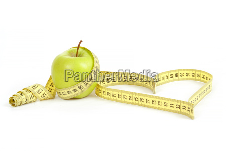 green apple with a measuring tape