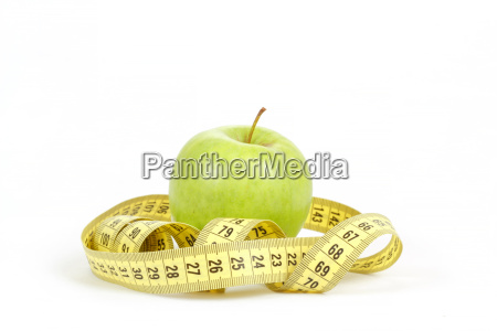 green apple and measuring tape isolated