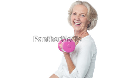 joyous fit woman lifting dumbbells