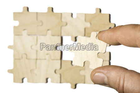 wooden puzzle on white background