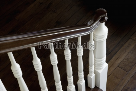 end of traditional wooden bannister and