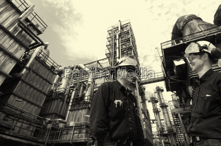 oil and gas workers inside refinery