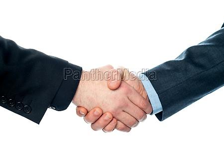 businessmen shaking hands closeup shot