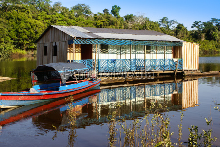 houses on stilts rise above the