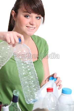teenage girl sorting the recycling
