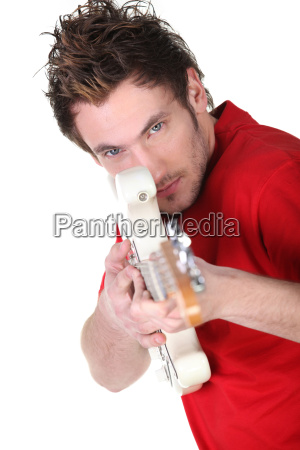 man pretending electric guitar is a