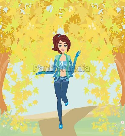girl running in the park autumn