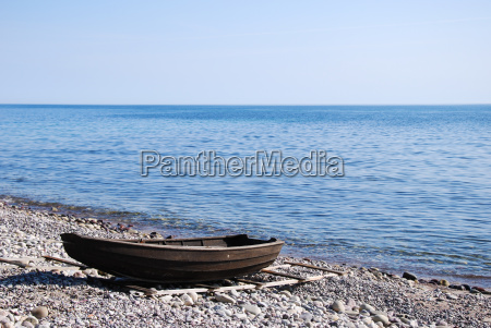 beached old rowing boat