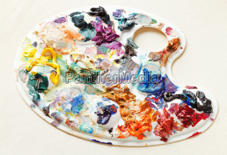 artistic pallette with oil paints on