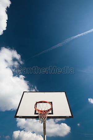 basketball hoop against lovely blue