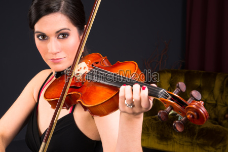 sensual attractive brunette woman playing concert