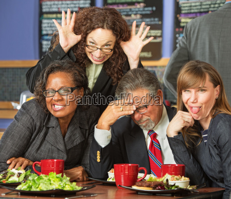 business people in awkward pose