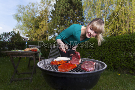 woman barbecuing