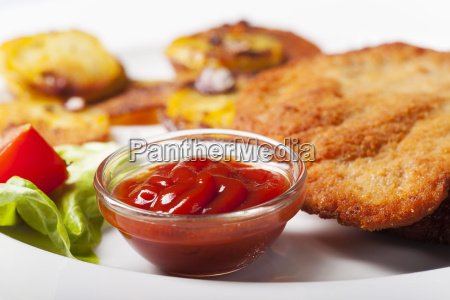 ketchup with a viennese schnitzel and