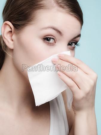 flu allergy sick girl sneezing in
