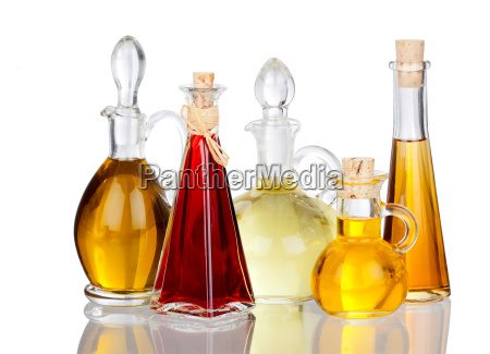different edible oils into bottles mirrored