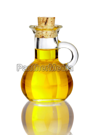 small glass carafe with olive oil