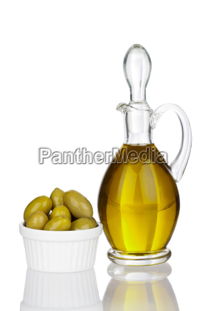 carafe of olive oil and olives