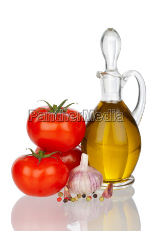 carafe with olive oil tomatoes and