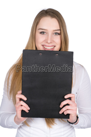 young woman looking over a clipboard
