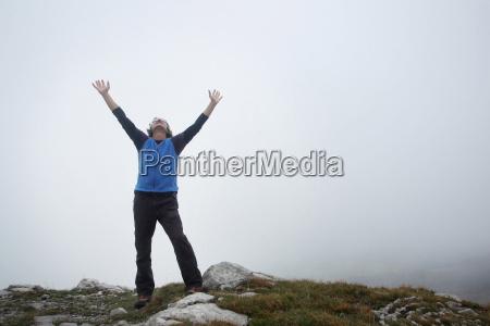 man enjoying the mountain