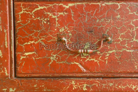 detail of cracked red drawer